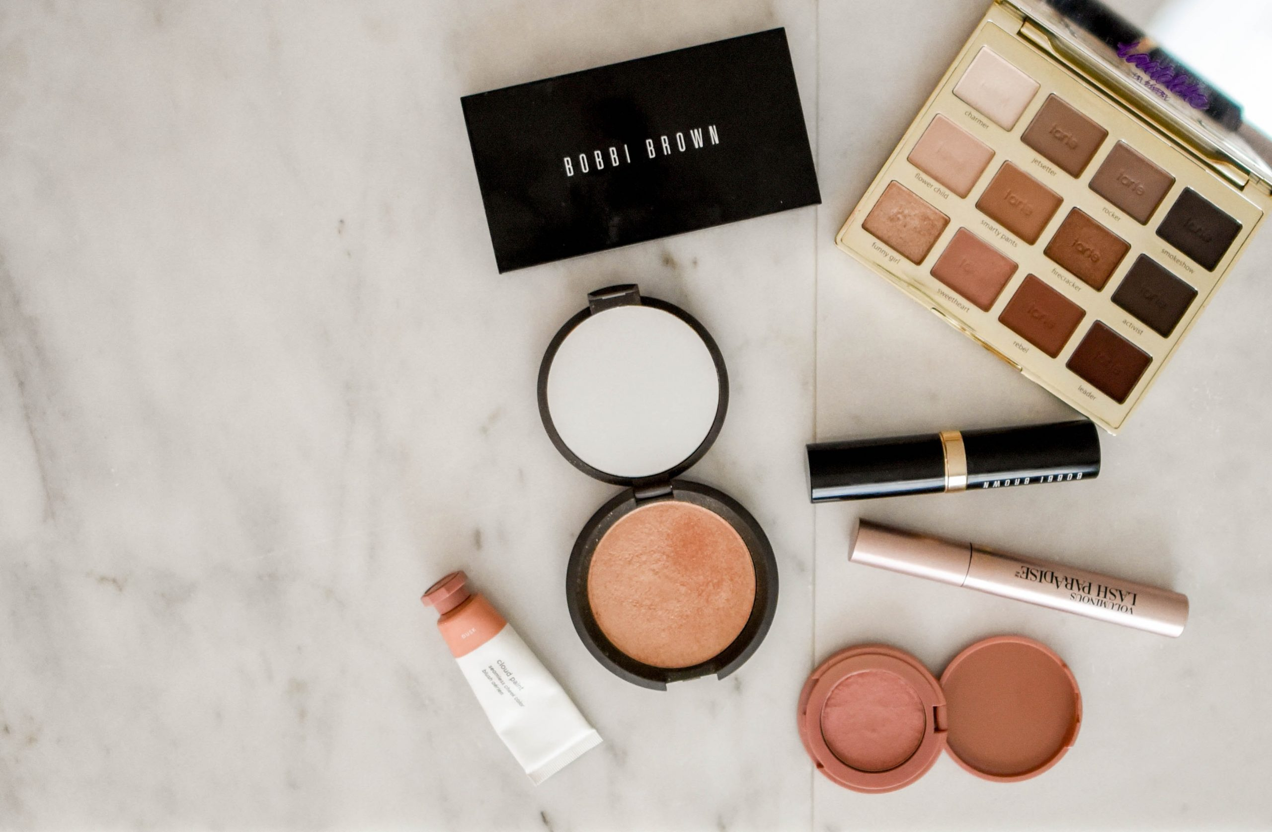 selection of makeup for healthy skin on tabletop
