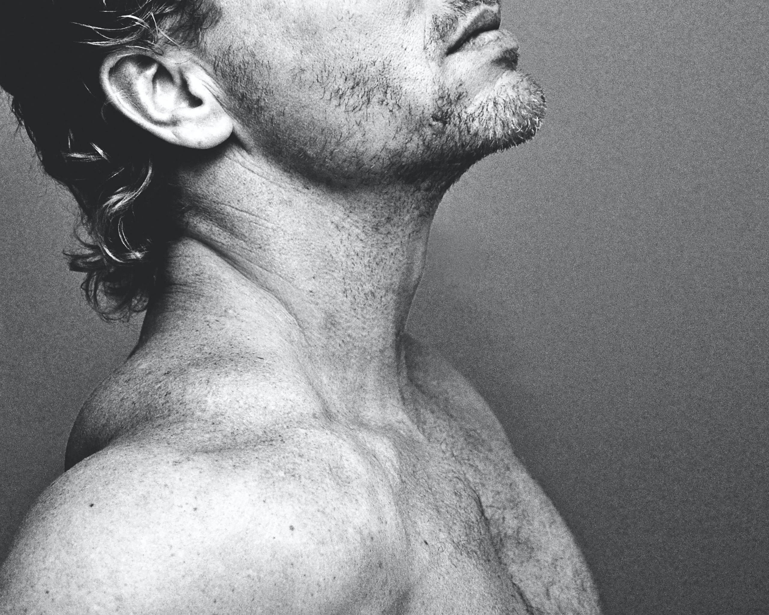 black and white closeup of man's chest & chin