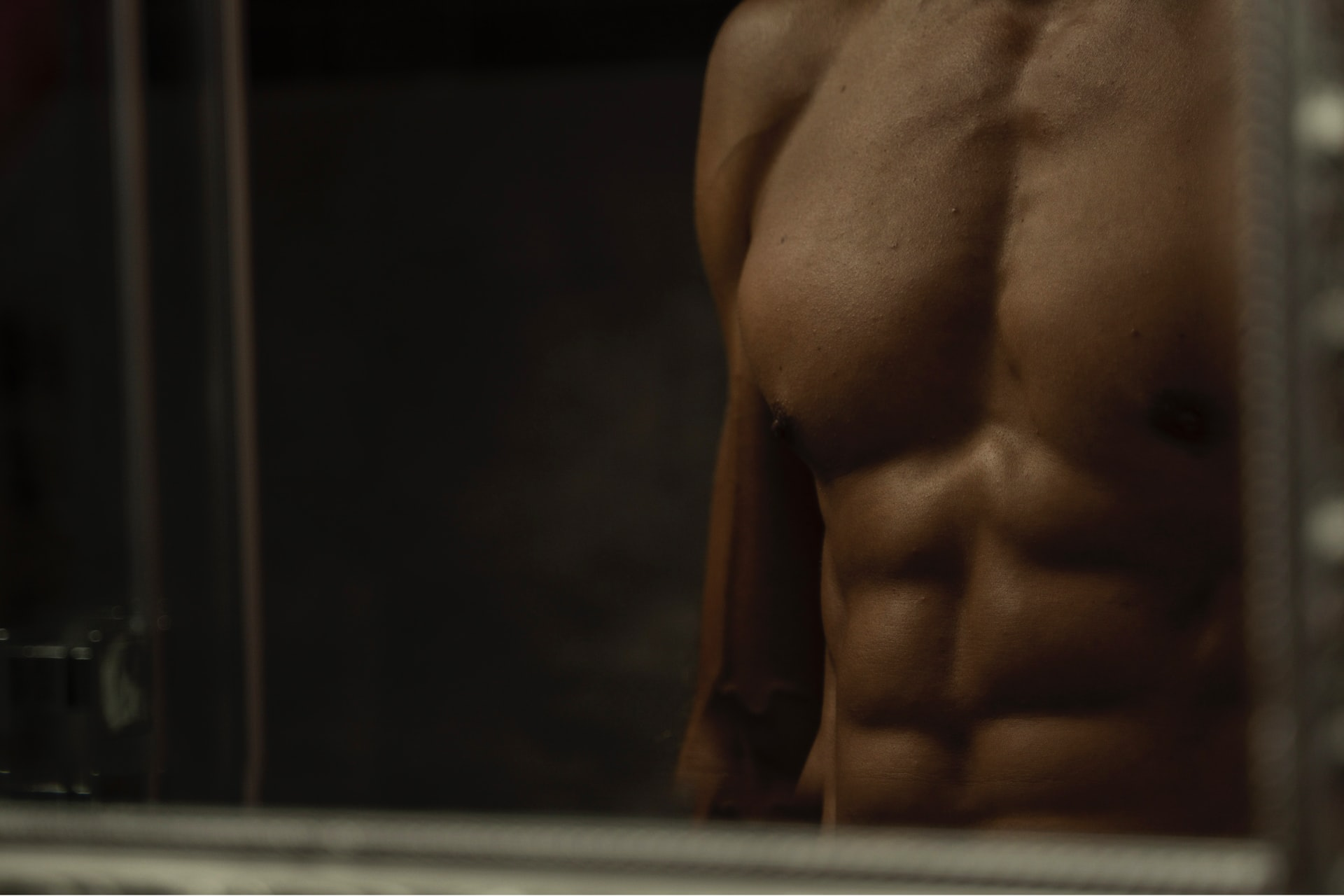 closeup of toned male body, how long does cool sculpting last