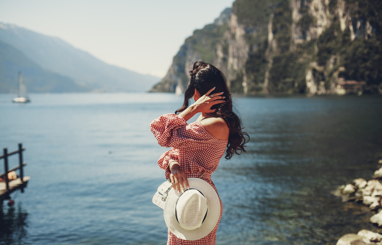 Person Looks Out To Sea In The Summer Sun, How To Manage Acne This Summer