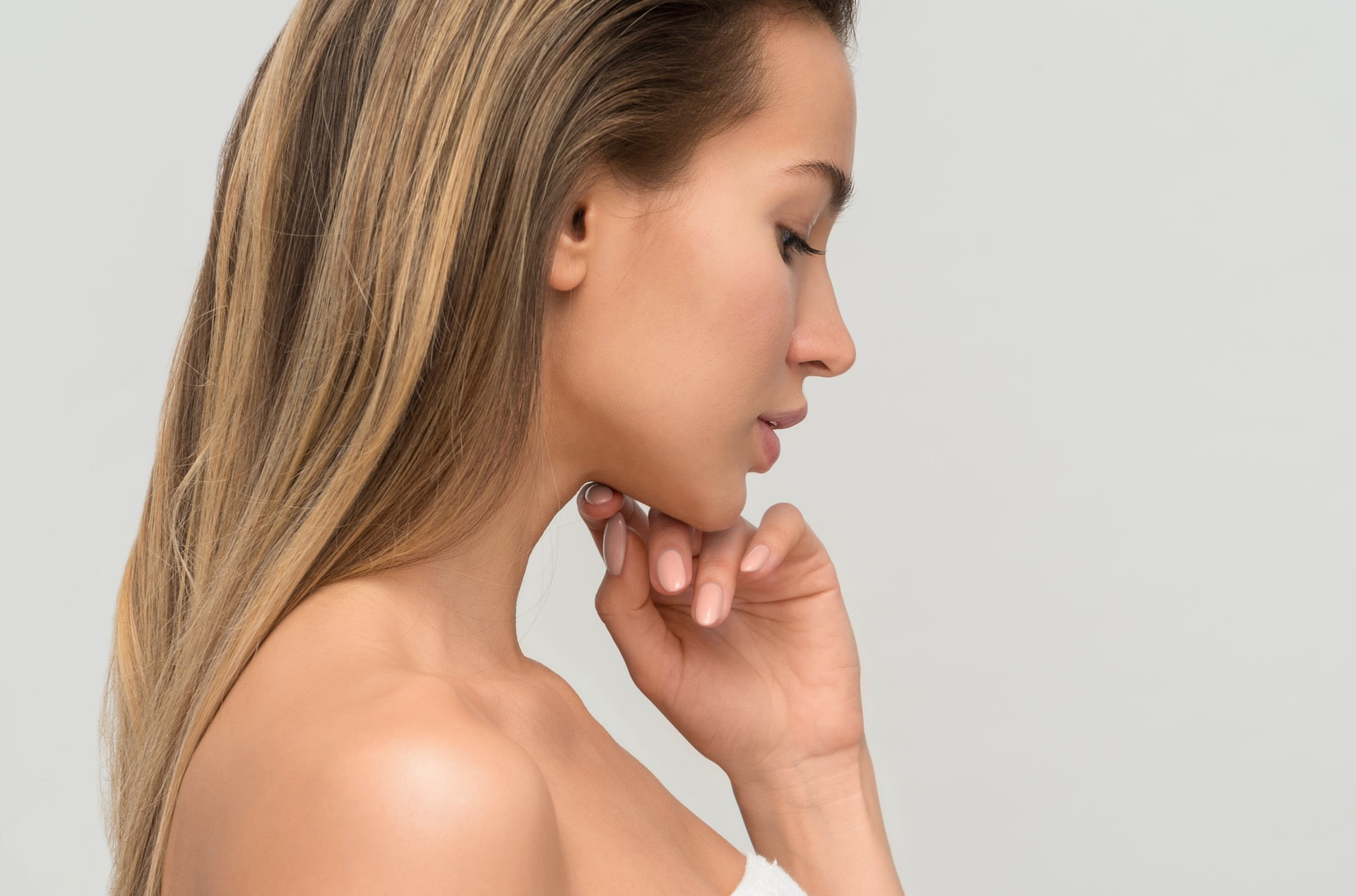 Person Looking Thoughtful, Hand On Chin, Ready For Night Time Skincare Routine