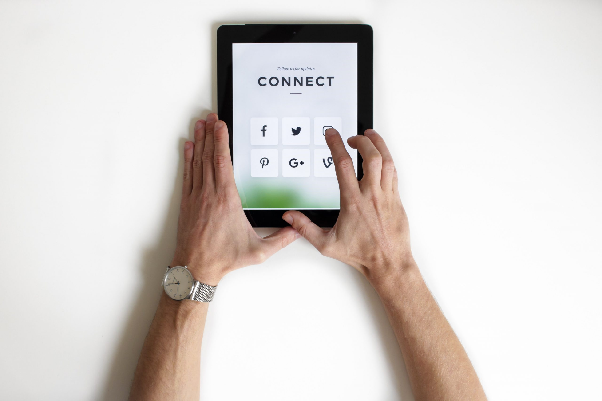 pad/device with social connecting options on-screen, hands interacting