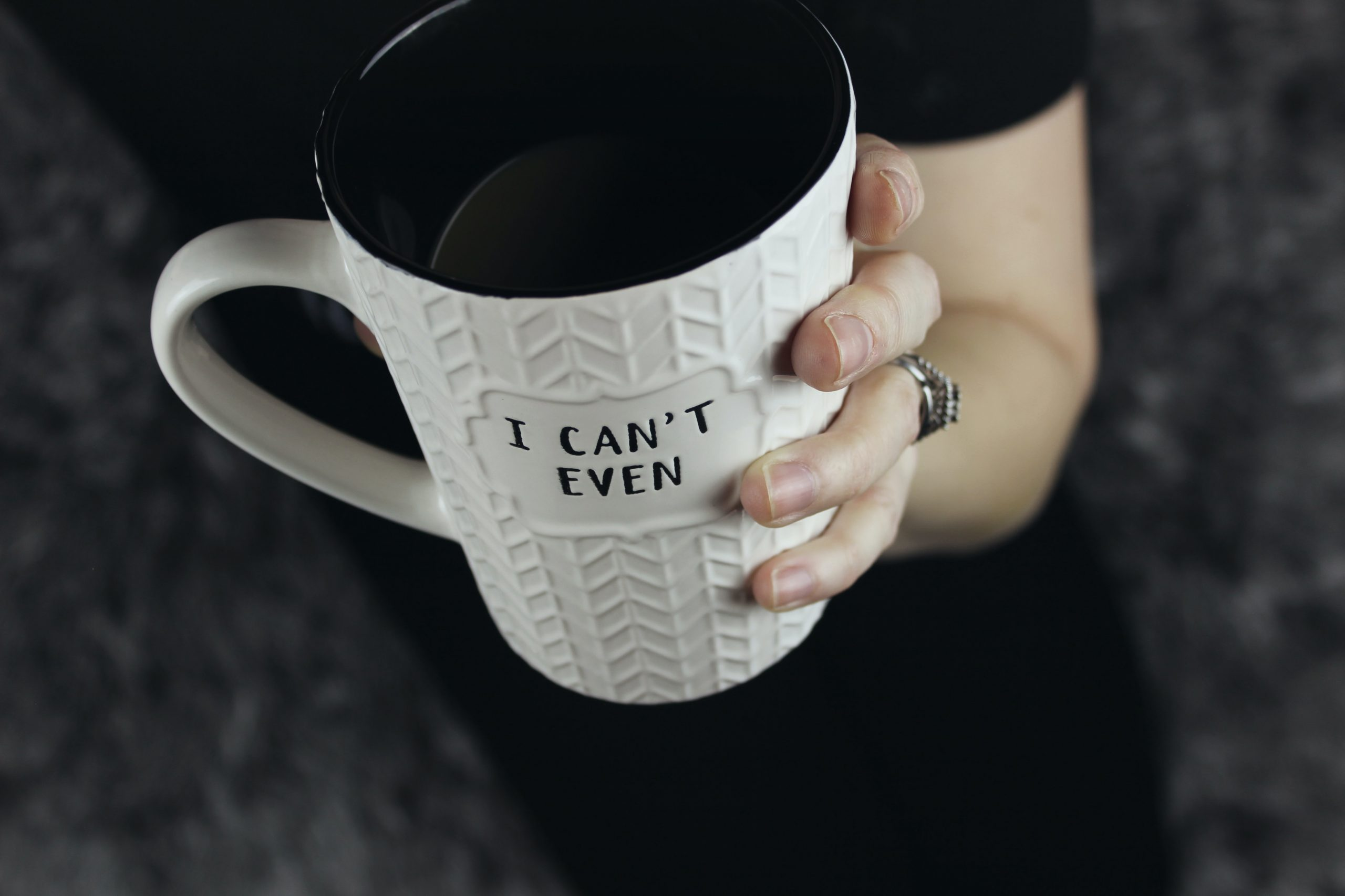 hand holding giant coffee cup